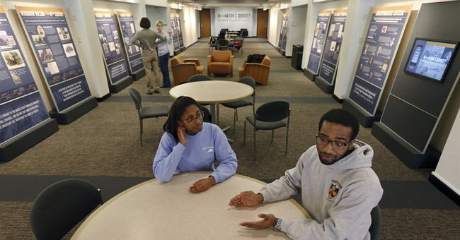 The Latest: Princeton president credits student group