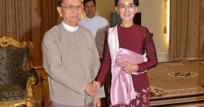 Myanmar's former president leaves office, joins monkhood
