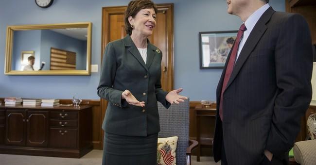 GOP senator meets with Garland, says hearings should be held