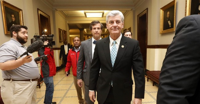 The Latest: Conservative leader praises Mississippi law
