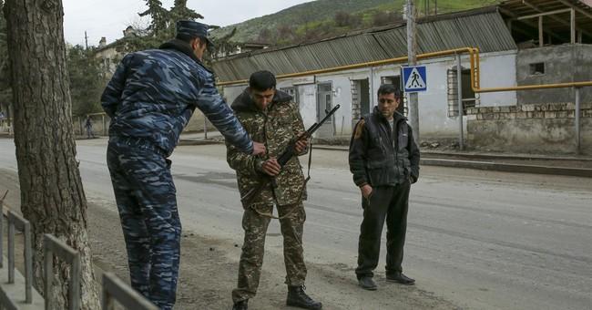 Azerbaijan's says cease-fire agreed with Nagorno-Karabakh