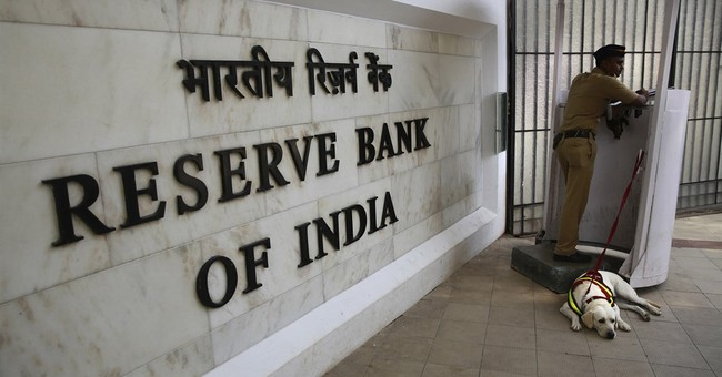 India's central bank cuts key lending rate to 6.5 percent