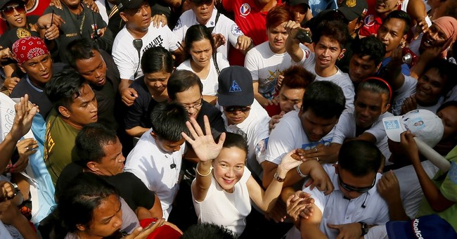 Life story, movie star father lift Poe in Philippines' race