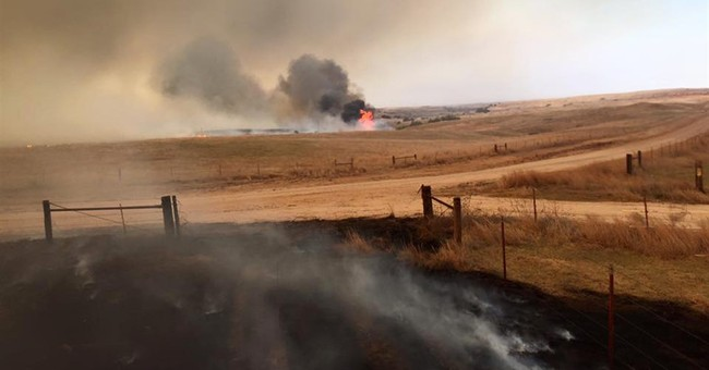 Firefighters hope to contain Oklahoma blaze as winds subside