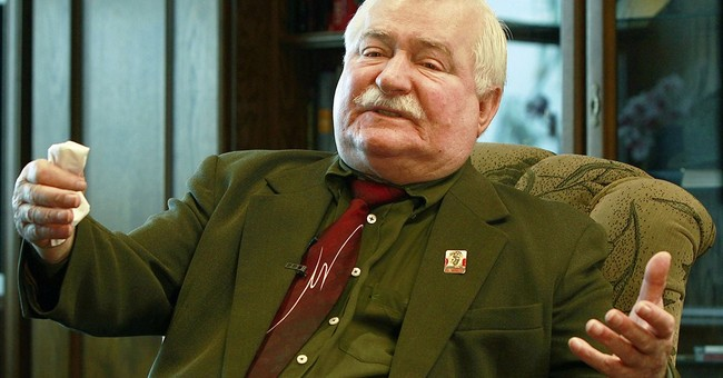 AP Interview: Walesa is tired of collaboration questions