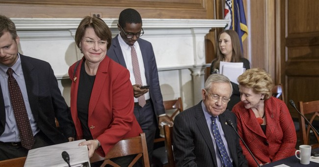 Nominee Garland smiles, stays quiet while in public view