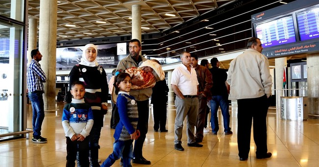 First Syrians arrive in US under surge resettlement program