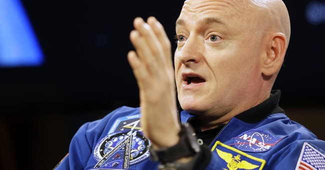 Astronaut Scott Kelly is writing a book, scheduled for 2017