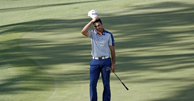 The Latest: Tears, frustration cap blustery day at Masters