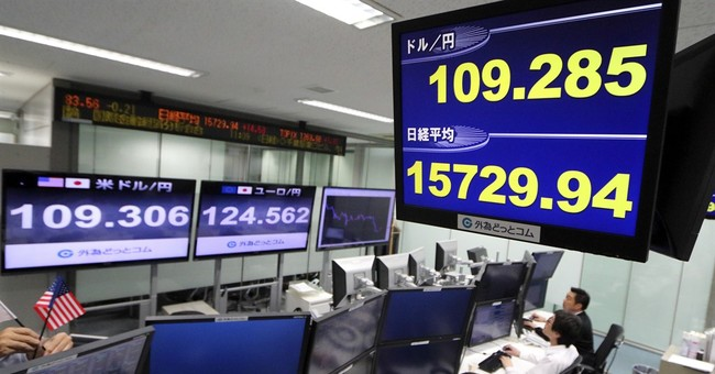 Asian stocks slip on Wall Street loss, yen's strength