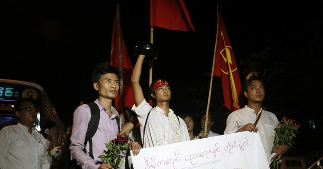 Myanmar frees over 100 political prisoners, but jails 2