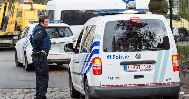 The Latest: Belgium: Suspect admits to being 'man in hat'