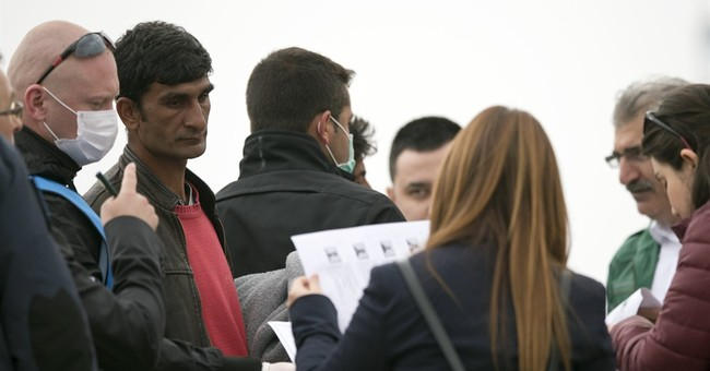 The Latest: Serbian police arrest people-smuggling suspects