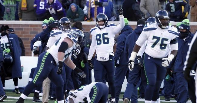 Seattle Seahawks Won't Take A Knee Or Sit During National Anthem