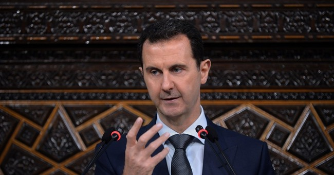Dozens of Officials Break With Administration, Call for Strikes Against Assad