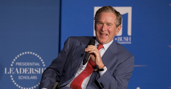 George W. Bush Takes Off on 100K Bike Ride With Veterans
