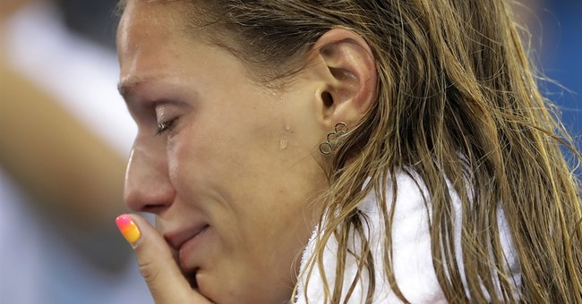 Russian Swimmer Accuses Media Of Trying To Reignite Cold War