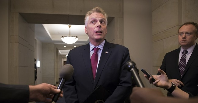 Gov. McAuliffe Pledges to Free Refugees Detained at Dulles Airport
