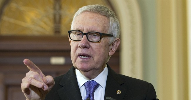 On His Way Out, Reid Also Slams the DNC