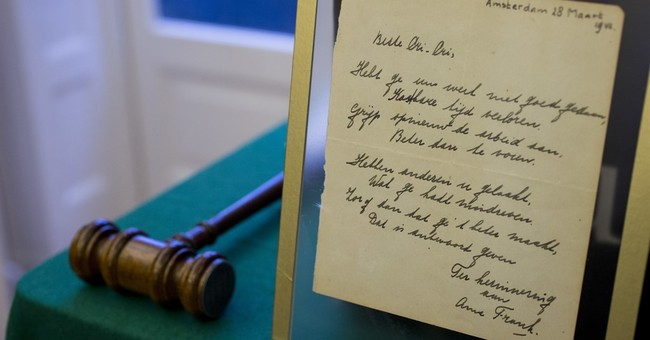 Poem signed by Anne Frank sells for nearly $150,000