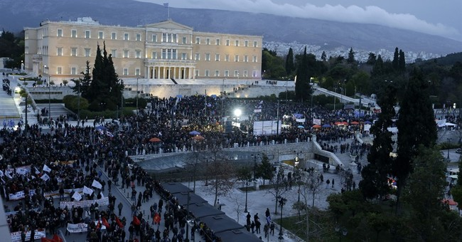 Greece Besieged by Crises, Mystified by Trump