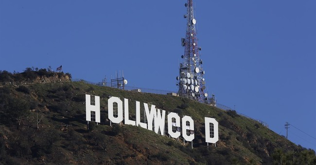 Vandalized Hollywood sign briefly reads 'HOLLYWeeD'