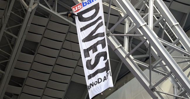 Stadium manager says protesters had tickets to Vikings game