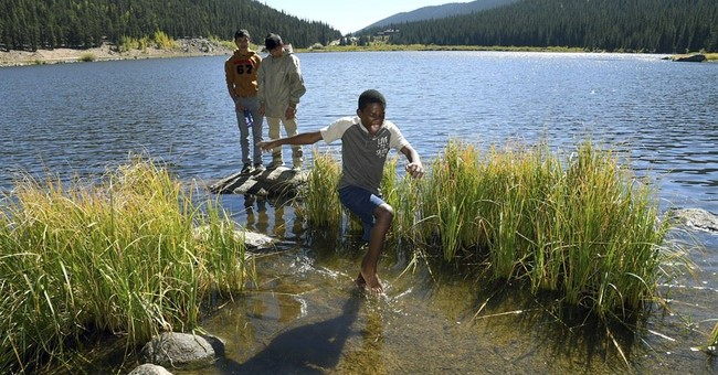 AP PHOTOS: Refugee Boy Scouts learn, bond on camping trips