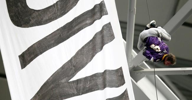 Oil pipeline protesters unfurl huge banner at Vikings game