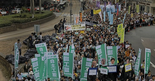 Thousands in Hong Kong march for pro-democracy lawmakers