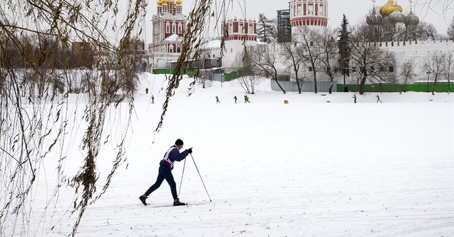 The Latest: Belgrade migrants line up for food in blizzard