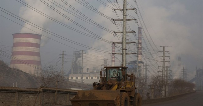 China pledges further cuts in excess steel, coal production