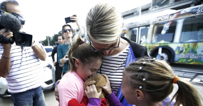 Girl gets back special teddy bear lost in airport shooting