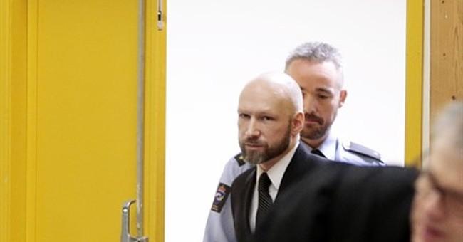 Norwegian mass murderer Breivik makes Nazi salute at court