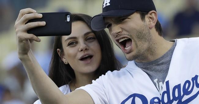 Ashton Kutcher emotionally thanks wife Mila Kunis for award