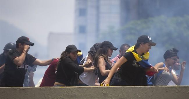 Venezuela protesters target Maduro, vow to keep up pressure
