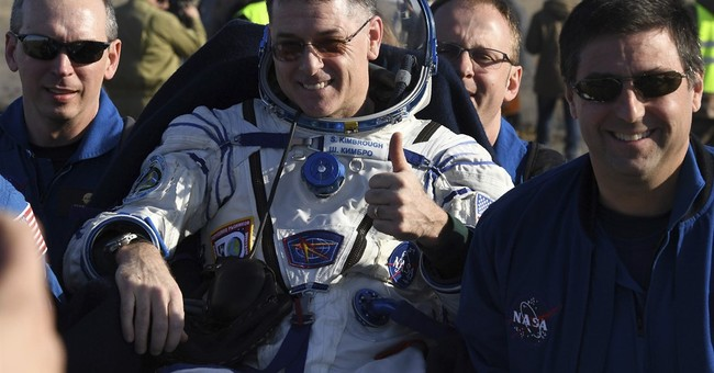 NASA astronaut and 2 Russian cosmonauts return to Earth