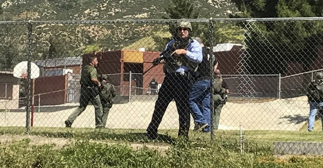 California gunman kills wife and student at school