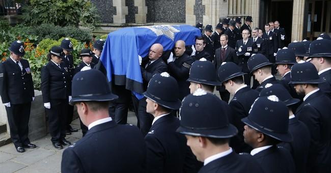 Day of tears: UK police honor officer slain near Parliament