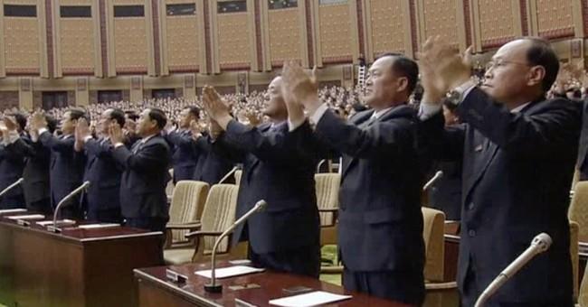 North Korea's parliament meets, with Kim Jong Un at center