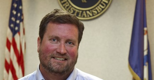 Town manager who denied harassing woman shoots self in head