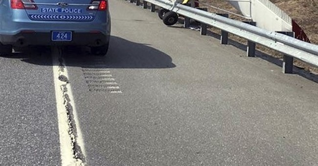 Plane makes emergency landing on highway, ends up nose-down