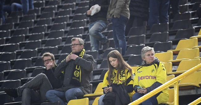 Dortmund fans open their doors to stranded Monaco supporters