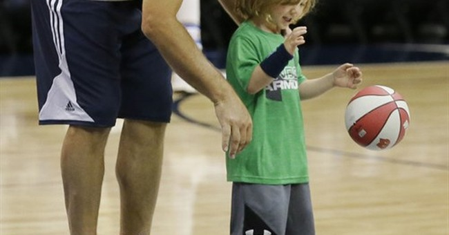 Romo's honorary Mav day turns spectacle for final home game
