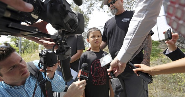 Boy killed in classroom was 'happy child' with rare disorder