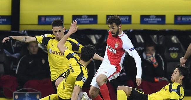 Police probe terror in Dortmund; team loses 3-2 after attack