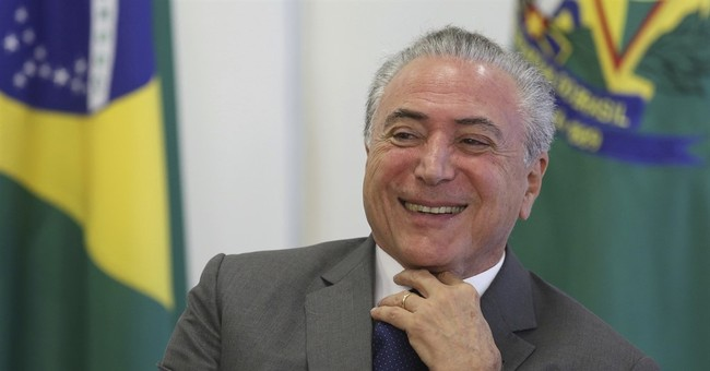 Ex-exec: paid millions in bribes to Brazil president's party
