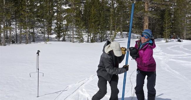 Howling wind. Icy hills. Tough trek to gauge California snow