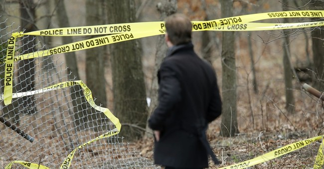 4 dead of injuries consistent with methods used by gang