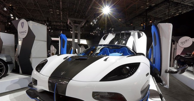 Auto show: High-priced, high-power super cars; a Tesla rival